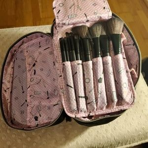 Black cosmetic bag with make up brushes